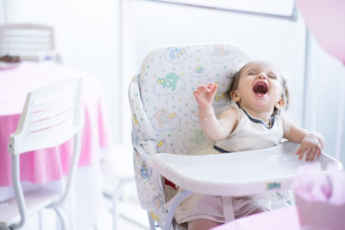 Child laughing. Clara Birthday Party Photography.